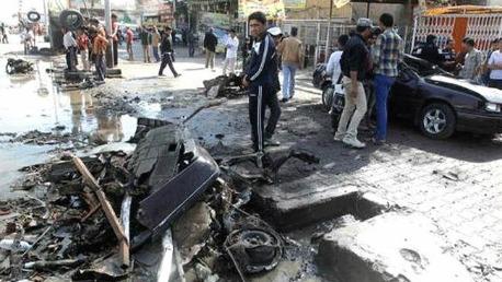 مقتل وإصابة العشرات بانفجارات في بغداد KK
